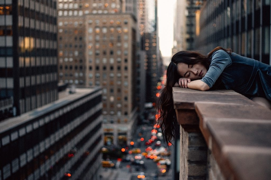 the power of micro nap and how to do it girl sleeping building